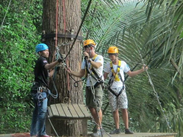 Hooking onto the zip line for safety